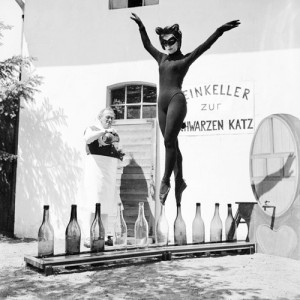 I knew that out there SOMEWHERE there were cool things, like, oh, maybe, shapely masked cat women dancing balanced on bottles.
