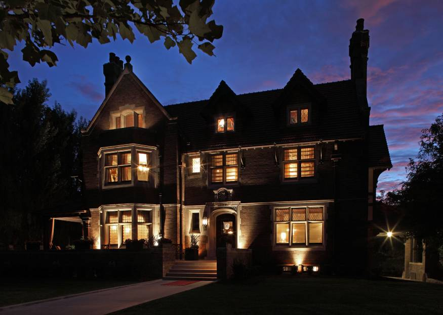 The 1904 Brandeis Mansion in Omaha's twilight. One of the mansion's owners, Mark Mazer,